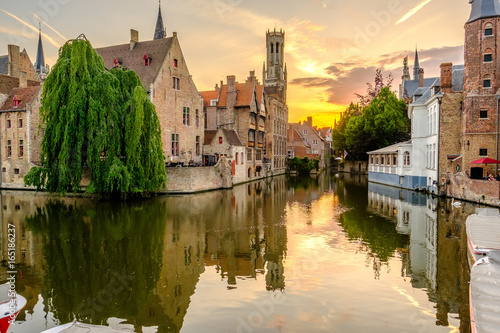 Wall Murals Bridges Bruges (Brugge) cityscape with water canal at sunset