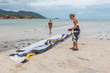 Surfers Preparing Their Kite
