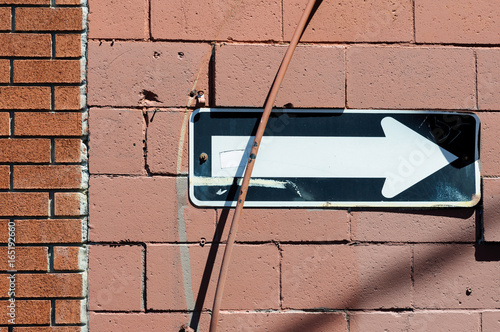 One-way street sign on a brick wall - 165192660