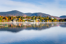 Beautiful Village Of Lake Placid From A Foggy Mirror Lake In Autumn At Sunrise
