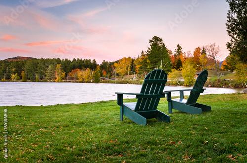 Cuadros en Lienzo Adirondack Chairs on a Lakeside Lawn at Dusk