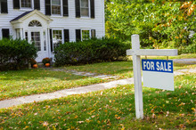 Real Estate Sign In Front Of A...