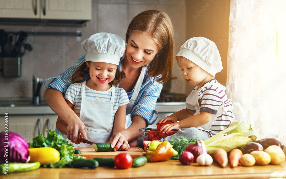Fototapety, obrazy: Healthy eating. Happy family mother and children prepares  vegetable salad