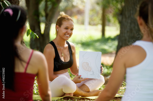 Antenatal Class With Doctor And Pregnant Women In Park Canvas Print