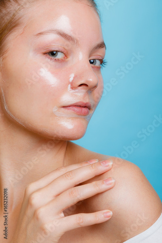 Fototapety, obrazy: Woman in facial peel off mask.