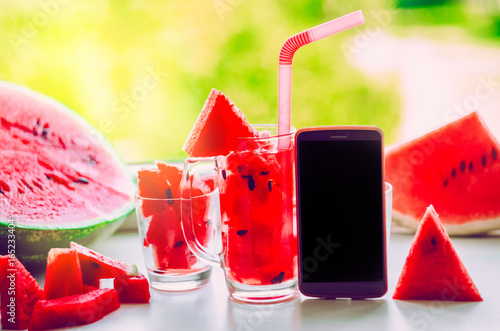 A juicy berry drink and a phone for viewing