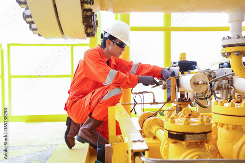 Electrical and instrument worker inspect and checking voltage and