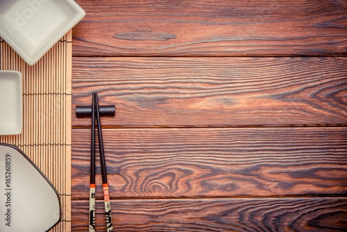 Sushi accessories on a brown wooden background Canvas Print
