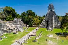 TIKAL, GUATEMALA - MARCH 14, 2016: Tourists At The Gran Plaza At The Archaeological Site Tikal, Guatemala