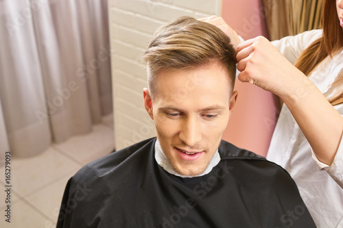 Caucasian Male In Hair Salon Young Man With Undercut Haircut Guide