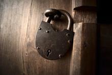 Old Iron Padlock On A Wooden Door