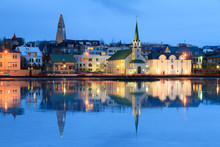 Beautiful Reflection Of The Cityscape Of Reykjavik In Lake Tjornin At The Blue Hour In Winter