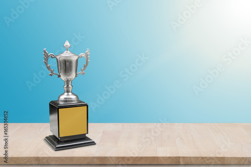 champion trophy placed on wooden table  copy space ready for