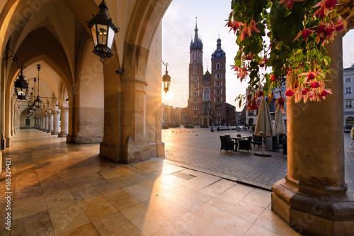 Fototapeta Old city center with St. Mary's Basilica in Krakow in sun lights. obraz
