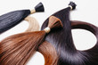 canvas print picture - hair extensions of three colors on a white background. copyspace selective focus