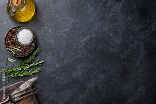 Poster Cuisine Cooking ingredients and utensils on stone table