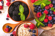Raspberry, blueberry with mint and oatmeal breakfast or smoothie.