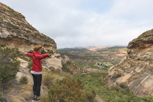 Tourist Standing With Outstretched Arms And Looking At The Panoramic View In The Majestic Golden Gate Highlands National Park, South Africa. Concept Of Adventure And Traveling People.