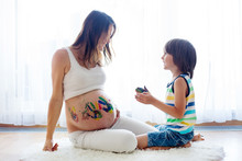 Happy Child, Boy, Painting On Mommy's Pregnant Belly