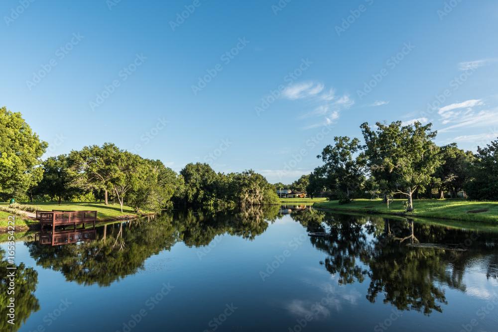 Fototapety, obrazy: Fishing Dock on Reflective Neighborhood Pond Tampa Florida  2