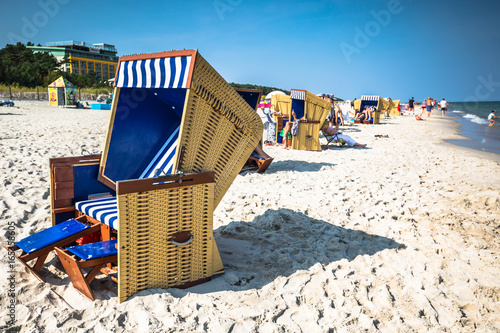 Foto auf Leinwand Nordeuropa Wicker chairs on Jurata beach on sunny summer day, Hel peninsula, Baltic Sea, Poland