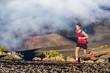 Leinwanddruck Bild - Trail running runner man on endurance run with backpack on volcano mountain. Ultra marathon race athlete on volcanic rocks path in mountains landscape.