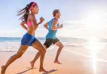 Healthy Active Runners Couple Running On Beach Working Out Cardio Together. Fitness Sports Lifestyle.