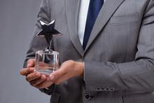 Businessman Holding Star Award...