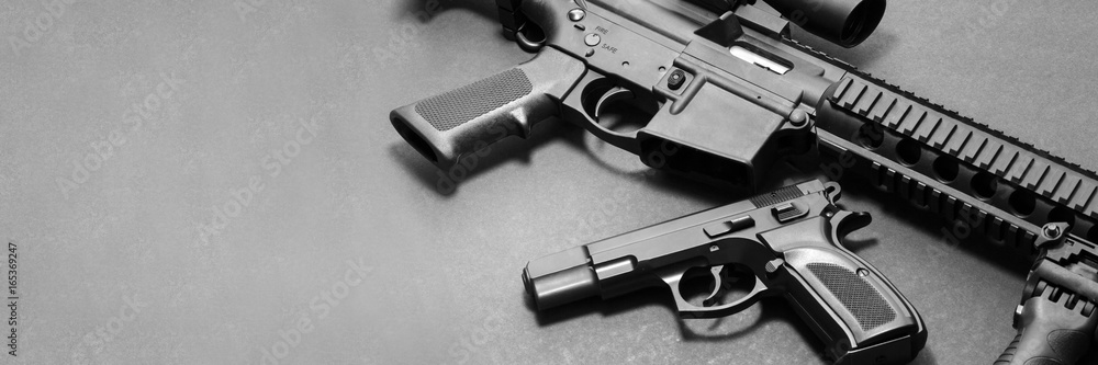 Fototapeta Handgun with rifle on gray background with copy space