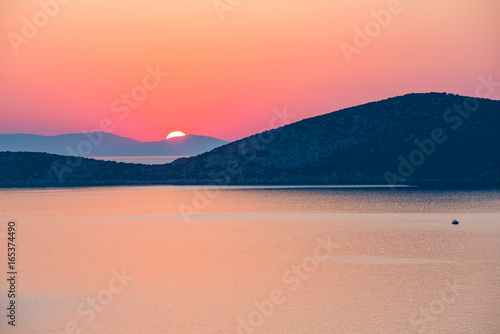 Colorful sunrise over sea in Greece