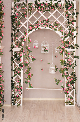 Photo  Shabby chic white decorating with beautiful vintage birdcage and flowers