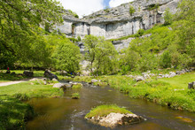 Malham Cove With The Stream At The Bottom Of The Rocks Yorkshire Dales National Park UK