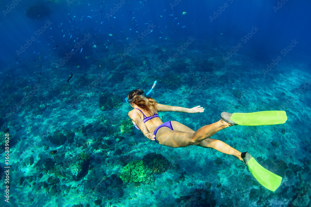 Fototapeta Happy family - girl in snorkeling mask dive underwater with tropical fishes in coral reef sea pool. Travel lifestyle, water sport outdoor adventure, swimming lessons on summer beach holiday with kids