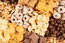 Different Corn Flakes Top View, Cereals Background.