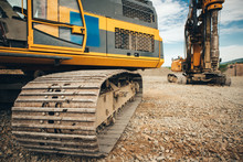 Close Up Details Of Excavator Tracks On Construction Site