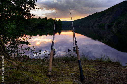 Printed kitchen splashbacks Fishing Freshwater fishing with rods on Vltava at sunset, Czech Republic