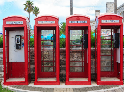 Four Red Phone Booths Poster