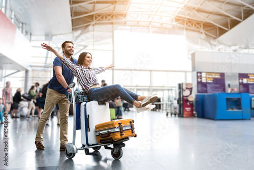 Fotografie, Obraz  Happy smiling couple having fun at airport