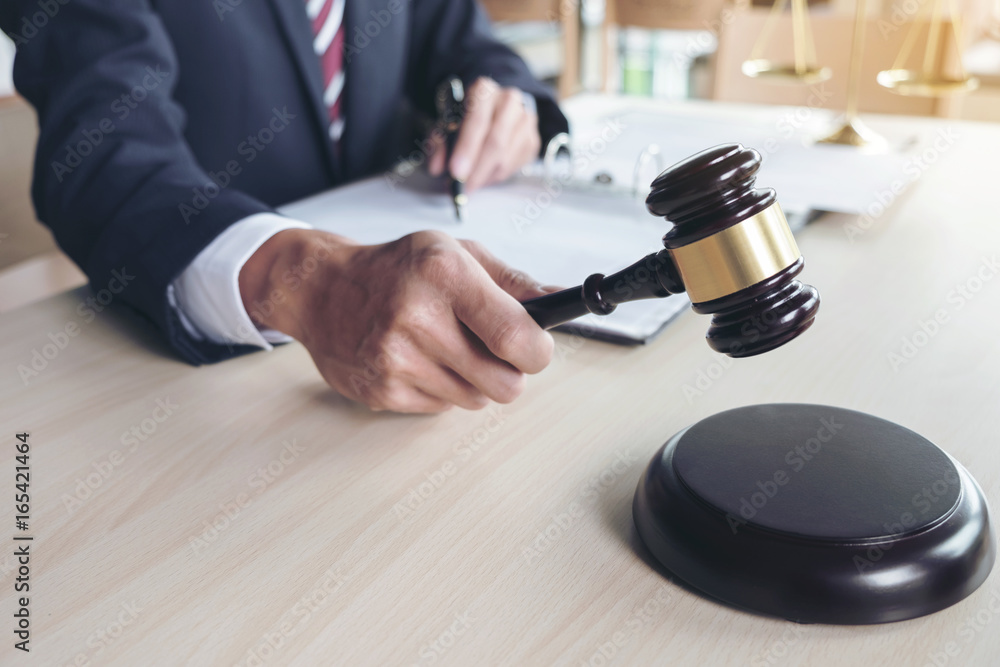 Valokuva  Close up of gavel, Male lawyer working with scales of justice, books, report the