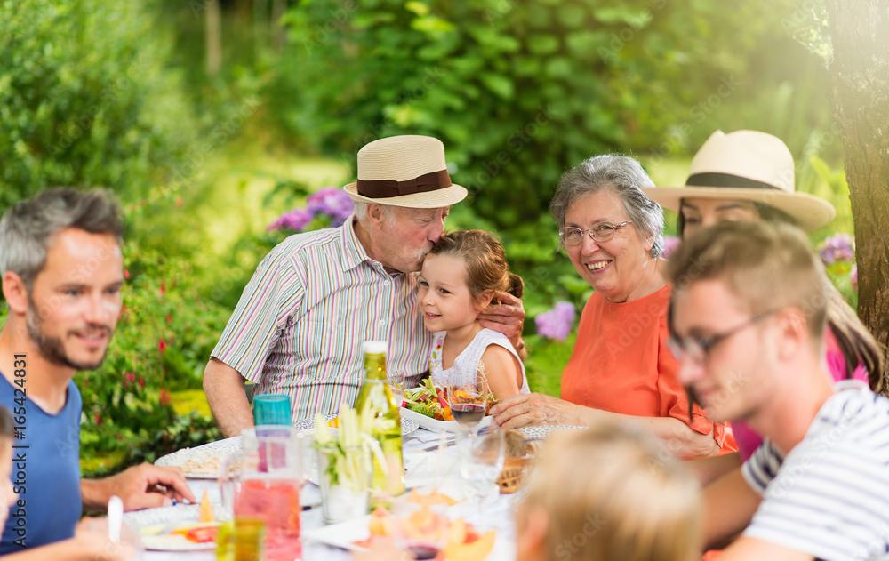 Fototapety, obrazy: Lunch in the garden for multi-generation family