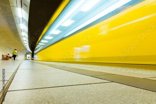Fotografie, Obraz  German Subway Yellow Wagon Long Exposure Passing Bend Light Streaks Urban Transp