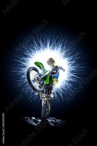 Photo  Professional dirt bike rider isolated on black background