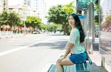 Girl Waiting For Transportatio...