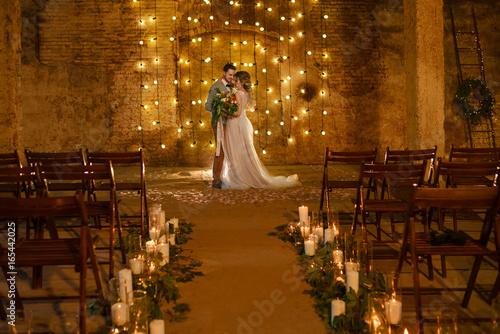 Cuadros en Lienzo Stylish hipster wedding couple in romantic loft decorations at night