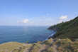 Promontory viewpoint in Phuket island and grass field is at sea side