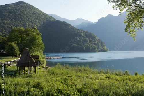 Fotomural Ledro lake, prehistoric stilt house (reconstruction), Trentino  - UNESCO World H