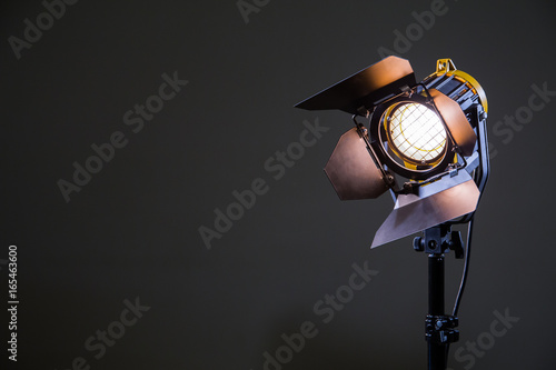 Fotografie, Obraz Floodlight with halogen lamp and Fresnel lens on a gray background