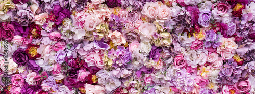 Poster Fleur Flower texture background for wedding scene. Roses, peonies and hydrangeas, artificial flowers on the wall. Banner fow website.