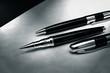 Elegant black pen on silver desk