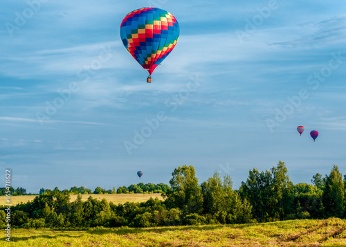 Poster Montgolfière / Dirigeable Colorful hot air balloons flying in the blue sky. Balloon Festival — The Golden Ring Of Russia — Pereslavl Zalesskiy.